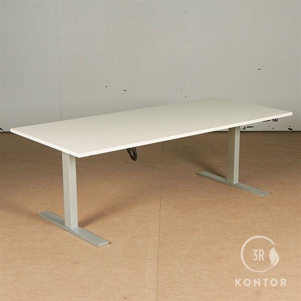 Image of   Hæve sænkebord. Hvid laminat, gråt stel.